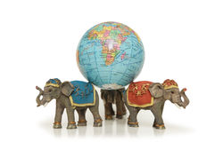 Three elephants holding earth Royalty Free Stock Photography
