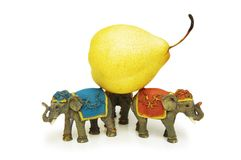Three elephants holding yellow pear Stock Photo