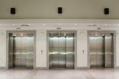 Three elevator doors in corridor Royalty Free Stock Photo
