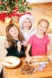 Three embracing kids Stock Images