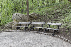 Three empty benches in a park in Uman Sophia Stock Photos