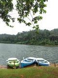 Three empty boats in front at Periyar lake, Kerala, India. THEKKADY, KERALA, INDIA - DEC. 15, 2011: Three empty boats in front at Periyar lake in Periyar Stock Photos