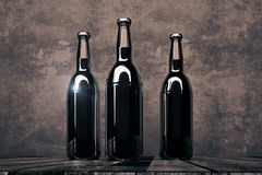 Three empty bottles on dark background Stock Photos