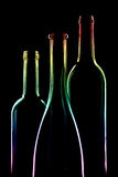Three empty bottles of rainbow Royalty Free Stock Photography