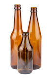 Three empty brown bottles Stock Photos