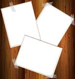 three empty cards on a wooden wall Royalty Free Stock Images