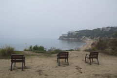 Three empty chairs in the coast Stock Images