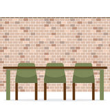 Three Empty Chairs With Long Table On Brick Wall Stock Photo