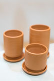 Three empty clay cups, selective focus on the front one Royalty Free Stock Image