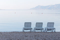 Three empty deck chair on the beach Royalty Free Stock Image