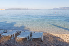 Three empty deck chair on the beach Royalty Free Stock Photography