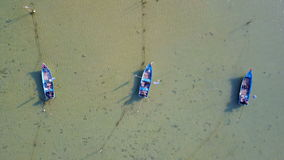 Three Empty Fishing Boats in Sea. Aerial View stock footage