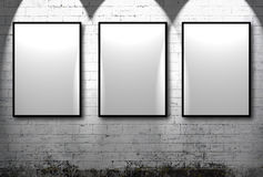 Three empty frames. Against a white brick wall Stock Images