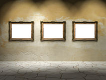Three empty frames on aged wall Stock Photos