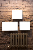 Three empty frames and radiator Royalty Free Stock Images