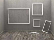 Three empty frames in a room Stock Photo