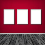 Three empty frames on a wall Stock Photos