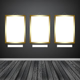 Three empty frames on a wall Royalty Free Stock Image