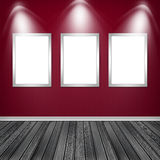 Three empty frames on a wall Stock Images