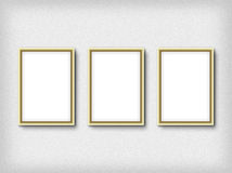 Three empty frames on a wall. High resolution texture Royalty Free Stock Images