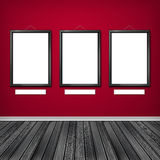 Three empty frames on a wall Royalty Free Stock Photo