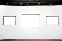 Three  empty frames on white wall Royalty Free Stock Photography