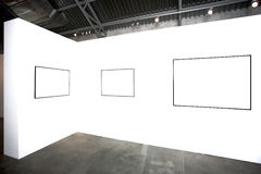 Three  empty frames on white wall Stock Photos