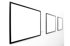 Three  empty frames on white wall Stock Photography