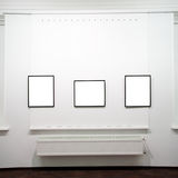 Three  empty frames on white wall Royalty Free Stock Photo
