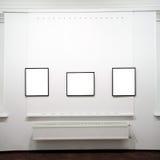 Three  empty frames on white wall Royalty Free Stock Photo