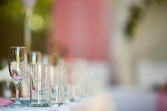 Three empty glasses on banquet table in restaurant Stock Photo