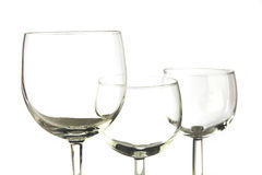 Three empty glasses. Closeup photo of three empty glasses on white background Royalty Free Stock Photo
