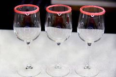Three empty glasses with sugar fringing stock photography