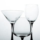Three empty glasses for wine, brandy and martini Stock Photo