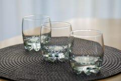 Three empty juice glasses Stock Photo