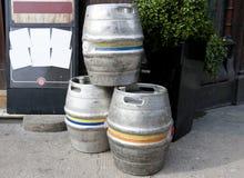 Three empty metal kegs. Outside a bar Royalty Free Stock Photo