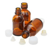 Three empty open amber glass pharmacy bottles Royalty Free Stock Images