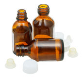 Three empty open brown glass pharmacy bottles Royalty Free Stock Photography