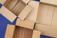 Empty open cardboard boxes on blue background royalty free stock image