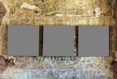 Three empty painting frames. On old wethered grunge wall Royalty Free Stock Photo