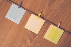 Three empty photo frames hanging with clothespins Royalty Free Stock Image