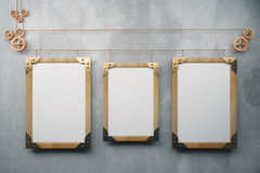 Three empty picture frame in the style of steampunk hanging on a Stock Photos