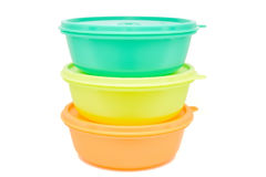 Three empty plastic bowls isolated. Close up three colorful plastic bowls stacked on each other on white background royalty free stock image