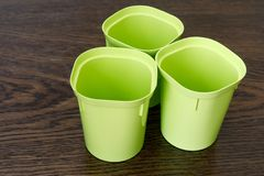 Three empty plastic cups for seedlings. Floriculture items stock photos