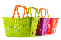 Three empty plastic shopping baskets on white Royalty Free Stock Photography