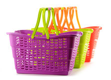 Three empty plastic shopping baskets on white Royalty Free Stock Images