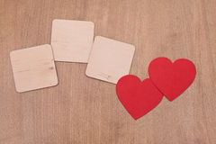 Three empty plates and two red hearts Royalty Free Stock Photography