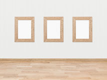 Empty wooden frames on a white wall Royalty Free Stock Photography