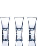 Three empty shot glasses Royalty Free Stock Photography