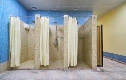 Three Empty Showers in modern Gym. Locker Room Royalty Free Stock Photo